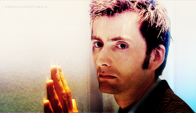 Image of the Tenth Doctor with his head and left hand against a wall, looking pensive.