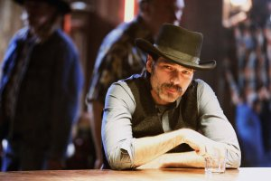 """WYNONNA EARP -- """"Keep the Home Fires Burning"""" Episode 102 -- Pictured: Tim Rozon as Doc Holliday -- (Photo by: Michelle Faye/Syfy/Wynonna Earp Productions)"""